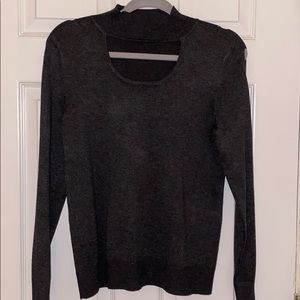 Gray sweater with opening on the chest